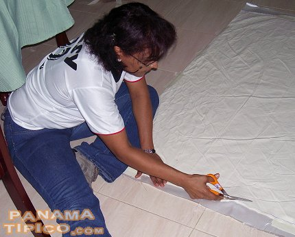 [The first step to build the flag is to cut the fabric, usually sateen.]