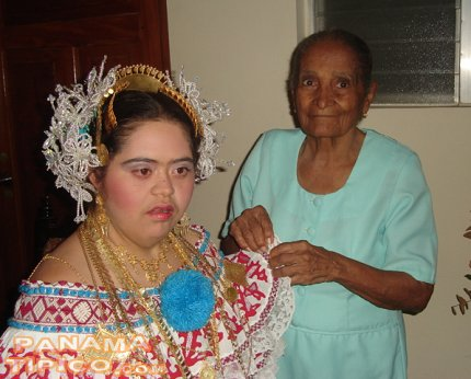 [The whole family helps in the dressing. Here we see a grand grandmother and her grand grandaughter.]