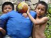 [Thumbnail: Kids from El Valle with a Old Year doll]