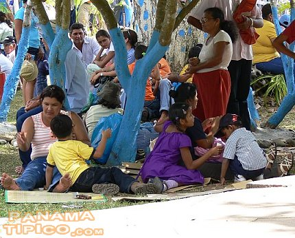 [The town squares become camping and resting grounds for these religious Panamanians.]