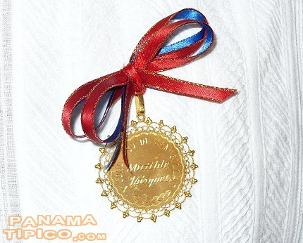 [The medal awarded to the winner of the camisilla contest is named in honor of a late artizan that made camisillas for decades.]