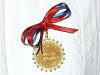 [Thumbnail: medal awarded to the winning camisilla.]