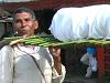 [Thumbnail: The guando is a traditional way of transporting a body.]