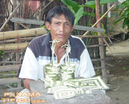 [A local from Ukupseni island shows us some bigbis among other handicrafts.]