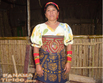 [The mola is sewn as a decoration of the blouse of the traditional Kuna woman's attire.]