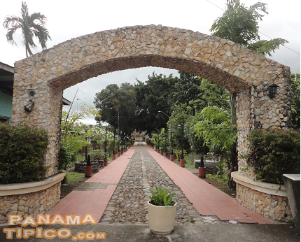 [In front of the museum and the foundation, this arch provides access to the stone-paved street that is the backbone of the historic neighborhood.]