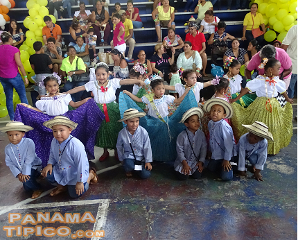 [Each grade group of students was dressed in traditional attire.]
