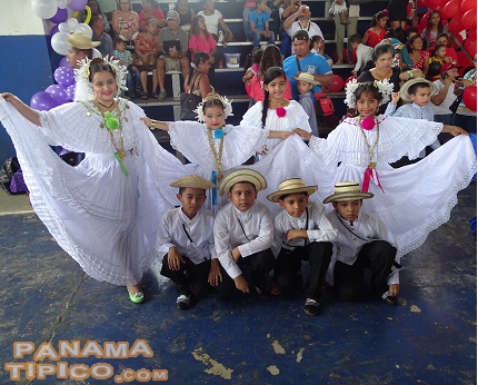 [The older students also wore polleras and camisillas for the celebration.]