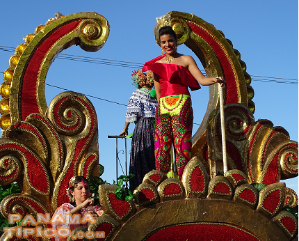 [The Queen participated in the parade from the top of a float.]