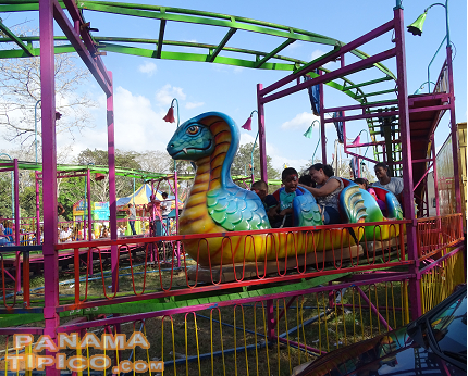 [Mechanical rides are one of the top draws of the fair for children.]