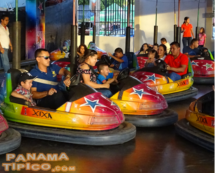 [A staple of our country fairs, the bumper cars, is enjoyed by children and adults alike.]