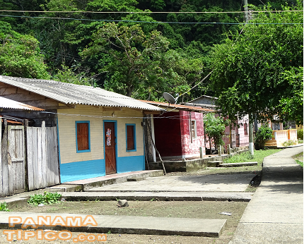 [At La Miel, there are no streets but walkways that snake around small houses made of wood and cement blocks.]