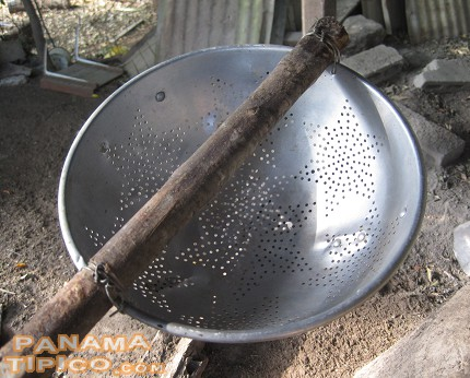 [This tool is called cazo. It is used for steering the guarapo an extracting the cachaza that forms on top of it while being cooked.]