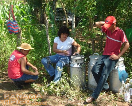 [Some of the workers are tasked with bringing water to the rice cutters.]