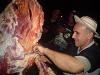 [Thumbnail: Cutting off meat at a matanza]