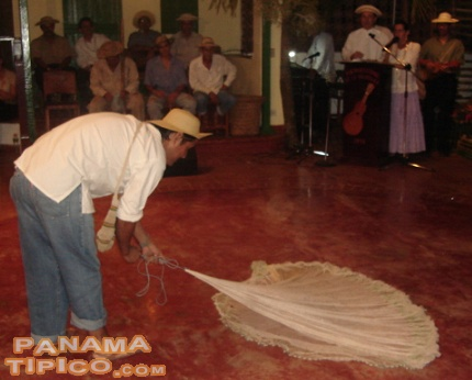 [The contestants not only wear the clothes, they also represent a traditional work. This one is showing the process of throwing a fishnet.]